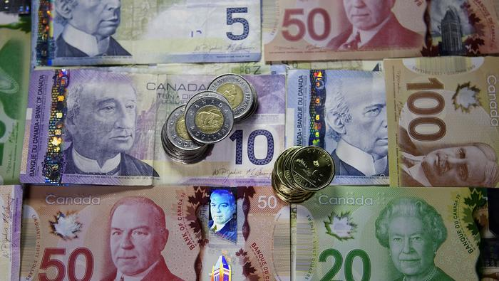 USD/CAD Slips Back Below 50-Day SMA as BoC Slows Pace of QE Program